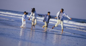family-running-on-beach-ks90066-outdoor-day-adults-man-woman-2